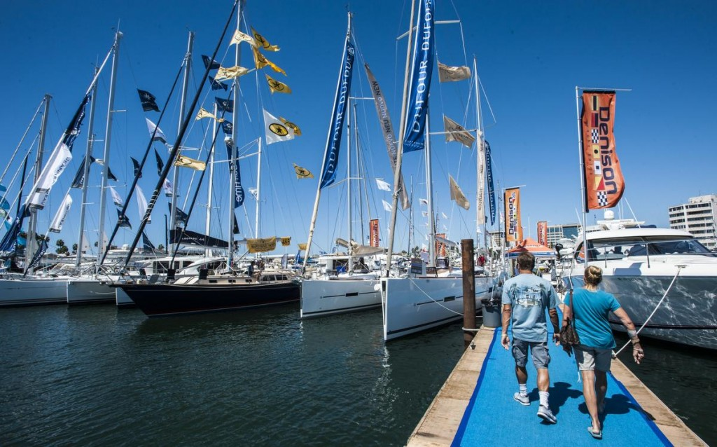 Visitors walk the docks around the Lido Boat Show at the Lido Marina Village in Newport Beach Friday afternoon. The show continues this weekend. ///ADDITIONAL INFORMATION: boatshow Ð 9/19/14 Ð MARK RIGHTMIRE, ORANGE COUNTY REGISTER -